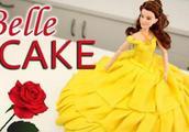 美女与野兽主题翻糖人形蛋糕,金黄裙摆的味道一定不错!