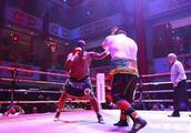 张君龙摧毁非洲巨兽获国际关注,中国重量级拳击让世界瞩目